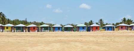 downshifting: Colorful huts on Agonda beach. South Goa, India