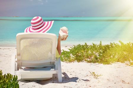 broad: Girl on the beach of Exuma, Bahamas