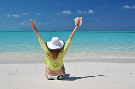 coolie hat: Girl on the beach. Great Exuma, Bahamas Stock Photo