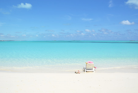 sunbed: Girl on the beach. Great Exuma, Bahamas Stock Photo