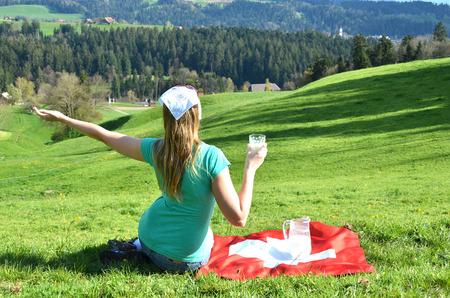 jag: Jug of milk on the Swiss flag. Emmental, Switzerland