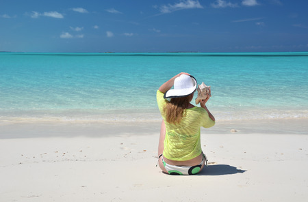broad: Girl on the beach. Great Exuma, Bahamas Stock Photo
