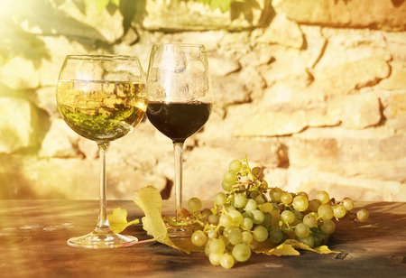 wine glass: Pair of wineglasses and bunch of grapes. Lavaux region, Switzerland