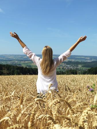 grain fields: Girl among a field of wheat. Switzerland