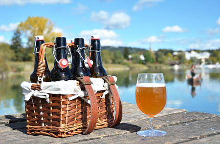 6 pack beer: Beer bottles in the vintage basket on a wooden pier