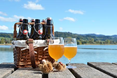 six month old: Beer bottles in the vintage basket on a wooden pier