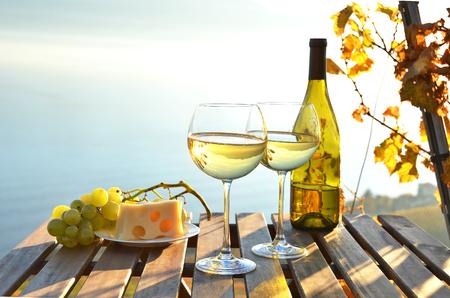 bottle of wine: Wine and cheese against Geneva lake, Switzerland Stock Photo