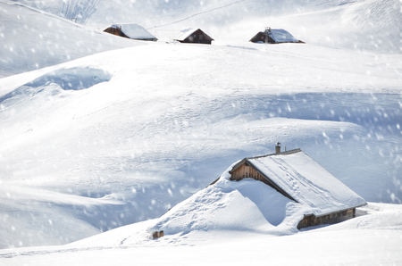 snow ski: Farm house buried under snow, Melchsee-Frutt, Switzerland