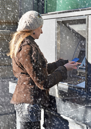 self operation: Girl at ATM Stock Photo