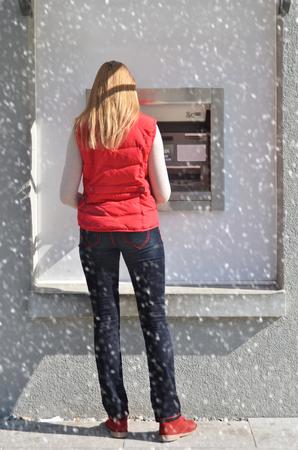 pincode: Girl at ATM Stock Photo