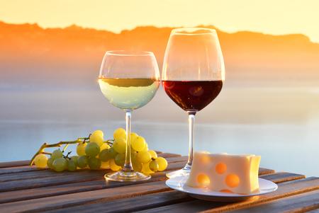 Wine and grapes against Geneva lake, Switzerland
