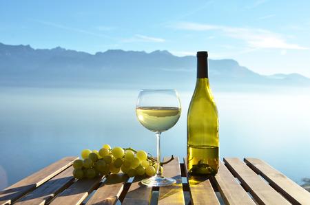 montreux: Wine against vineyards in Lavaux, Switzerland Stock Photo