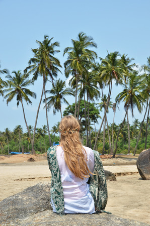 downshifting: Blond girl relaxing on Agonda beach of South Goa, India Stock Photo
