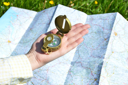 Traveler with a compass in the hand Stock Photo
