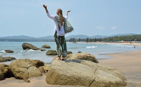 Blond girl relaxing on Agonda beach of South Goa, India Stock Photo