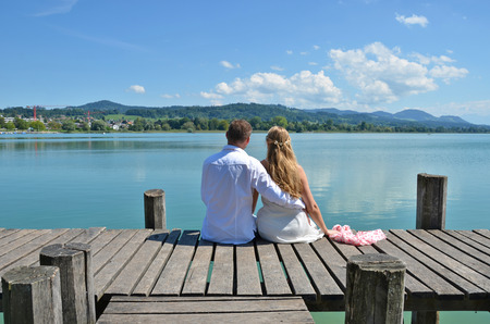 A couple on the wooden jetty at the lake. Switzerland Stock Photo