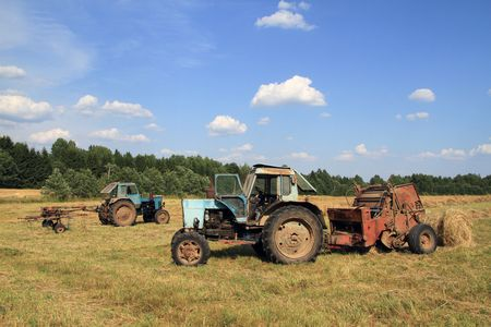 old tractors: Old tractors hay harvested. Stock Photo