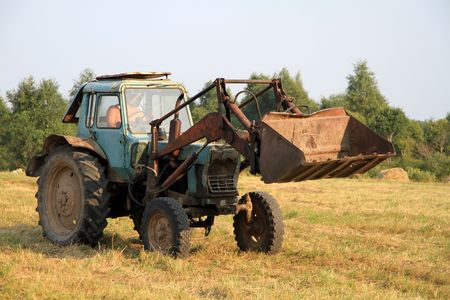 Tractor with a bucket on the farm. photo