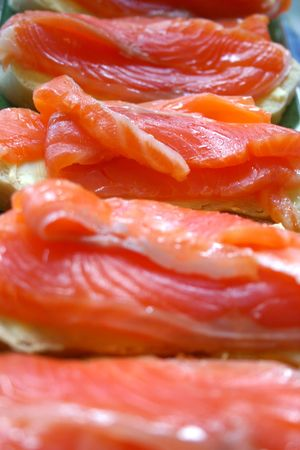 Appetizing sandwiches with salty red fish of a salmon. Abreast close up. photo