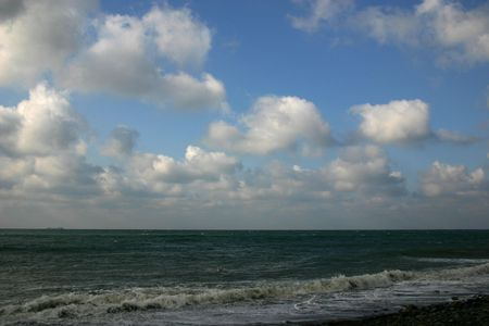 Sea surf wave clouds coastline spray sky russia photo
