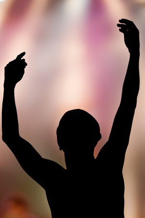 raising hands with colorful background Stock Photo