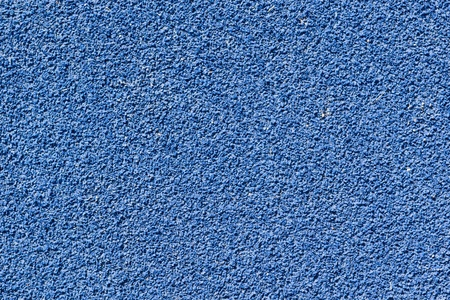 Blue tartan athletic running track on the stadium. Tartan track is the trademarked all-weather synthetic track surfacing for athletics made of polyurethane Stock Photo