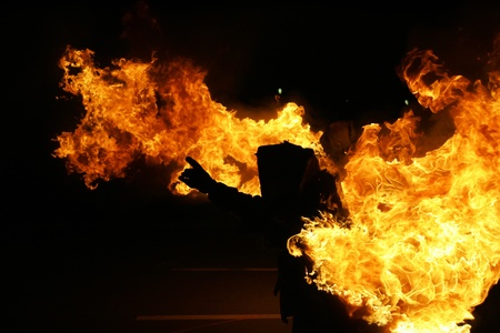 Burning stunt man showing a fire show