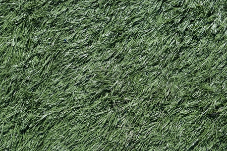 Green background of artificial plastic grass