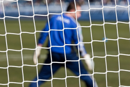 Football soccer goal net with grass background Stock Photo