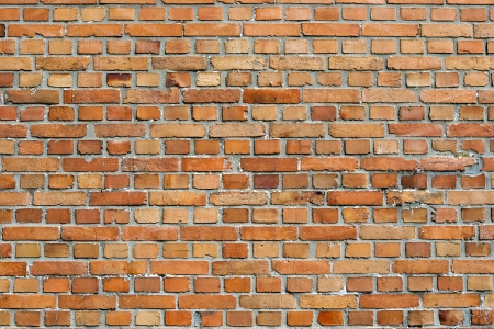alternating: Orangey red brick wall background texture and pattern with alternating rows of long and short bricks Stock Photo