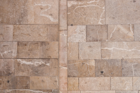 Stone wall or paving background texture with neat cut rectangular bricks or flagstones in random sizes arranged in rows Stock Photo