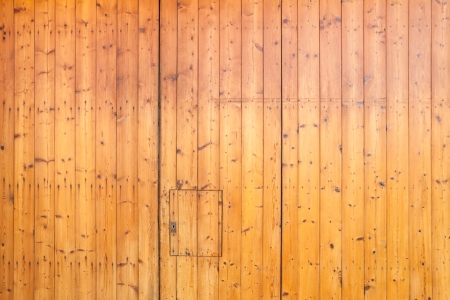 Hardwood flooring or paneling background with beautiful mellow brown sealed planks with woodgrain providing a natural interor building material