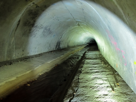Photo taken inside a running sewer and its infrastructure condition