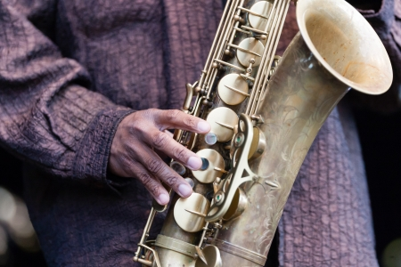 Hand and Saxophone of a musician Stock Photo