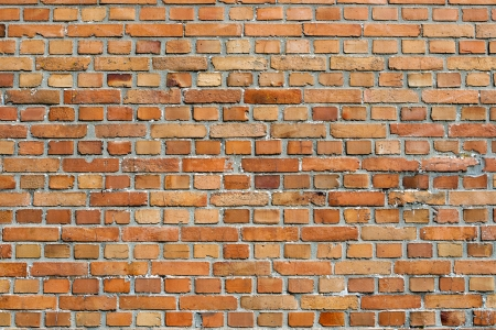Orangey red face brick wall background texture of unpainted clay bricks in a repeat pattern in neat rows Stock Photo