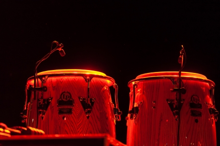 Steel drums illuminated on a stage during an orchestral performance at the Buena Vista Social Club Stock Photo