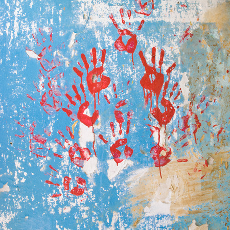 bloody hand print: red handprints on the old wall Stock Photo