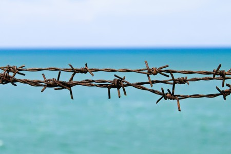 wire fence on the beach photo