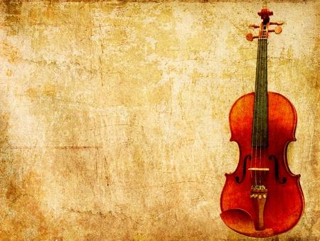 Grunge paper background of vintage violin photo