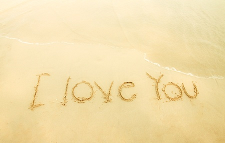 I love you on sand and beach photo