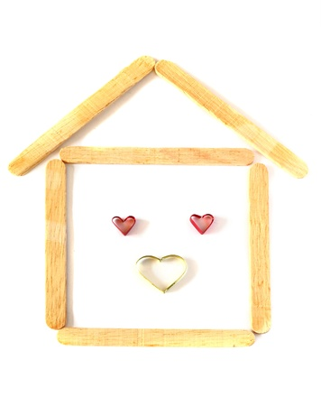 wood ice-cream stick in shape as a house with heart photo