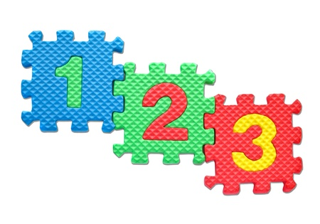 Number puzzles isolated on white background photo