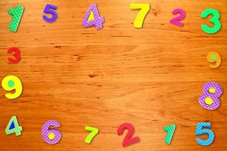 arabic number: Colorful frame number on wood table Stock Photo