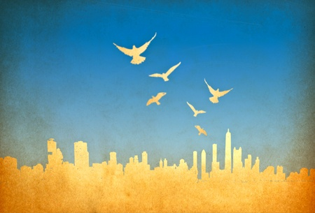 grunge image of cityscape with birds from old paper  photo
