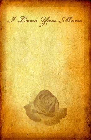 Message I love you mom with rose on old vintage paper with space  photo
