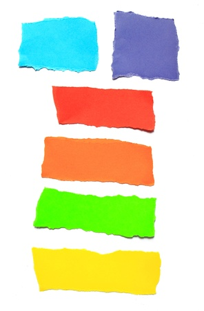 pieces of torn papers various color isolated photo