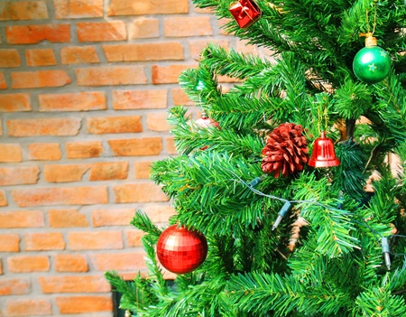 Christmas tree with brick wall and space photo
