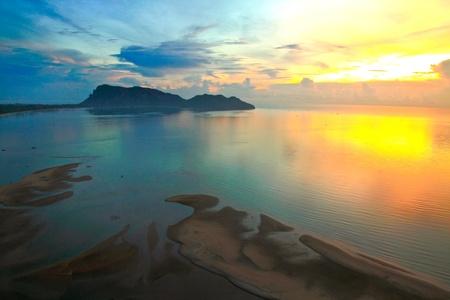 beautiful sunrise of the bay of Prachuap Khiri Khan in thailand photo