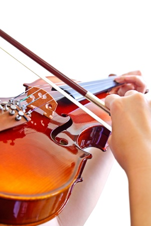 thai musical instrument: Ladys hand playing violin on white background Stock Photo