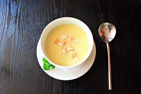 Cream soup with bread photo